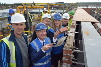 Final brick in place for new hospital