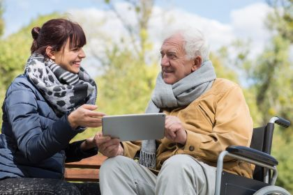 Man-and-lady-outdoors-on-iPad - RGB.jpg